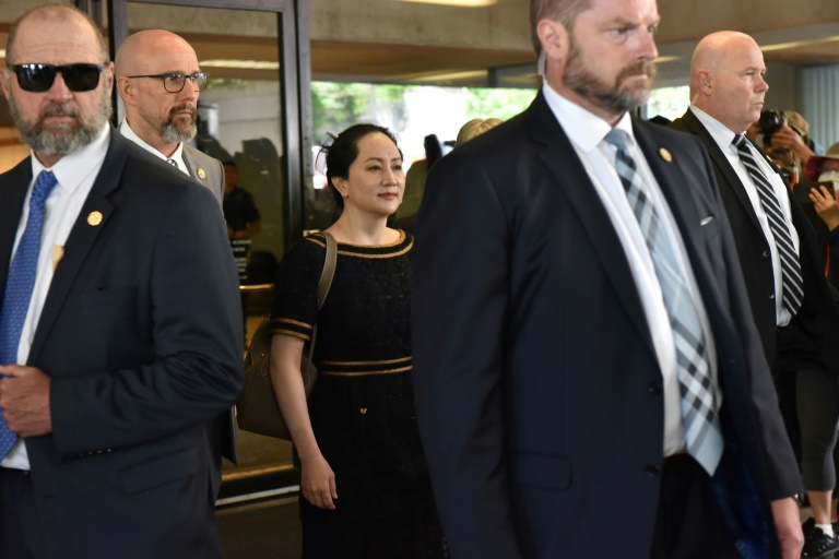 Huawei Chief Financial Officer, Meng Wanzhou (C), has been in a two-year battle against extradition to the US from Canada