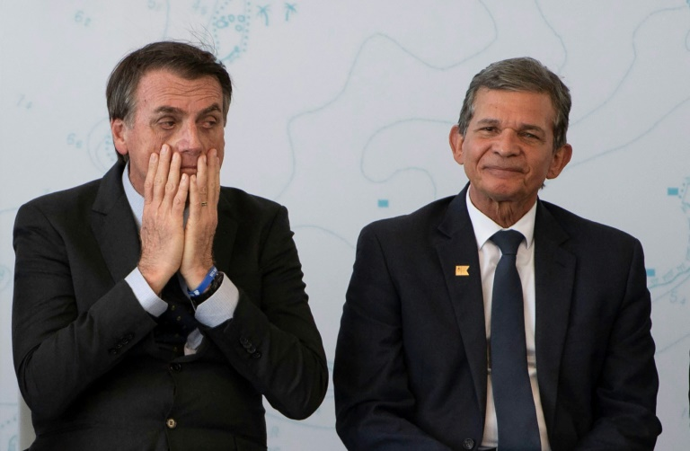 In this file photo taken on December 14, 2018, then-President-elect Jair Bolsonaro (L) and General Joaquim Silva e Luna attend a ceremony at a navy base in Itaguai city, Rio de Janeiro state